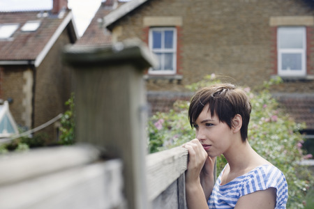 peep: Woman looking over fence