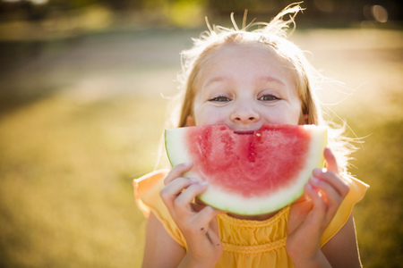 morsels: Young girl making smile with watermelon