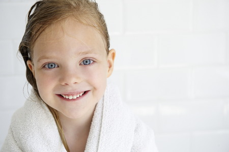 Girl in a bath towel,looking at camera