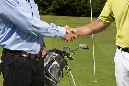 agrees: Golfer and caddy shaking hands