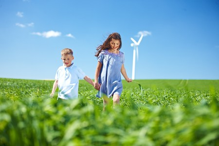 remoteness: Wind turbine,boy and girl on field LANG_EVOIMAGES