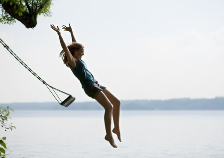 guts: Girl jumping from swing LANG_EVOIMAGES