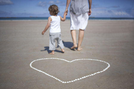 low section: Woman and son in front on the beach
