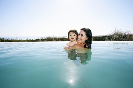 Mother with baby boy in swimming pool