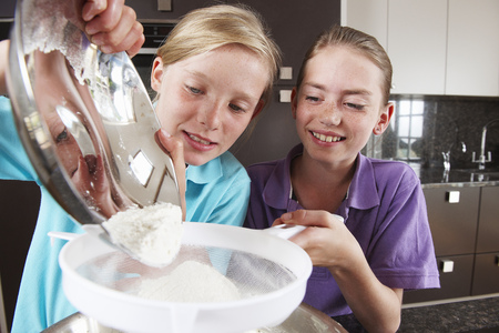 adds: Girls cooking in the kitchen