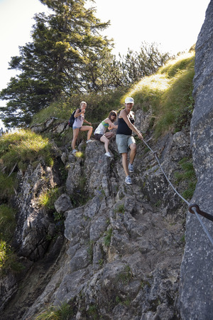 jeopardizing: Girls rockclimbing through the foothills