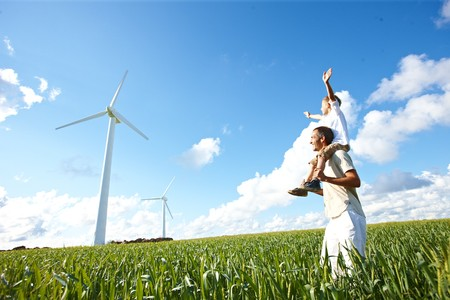 farther: Farther and son looking at wind turbine