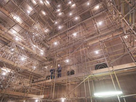 scaffolds: Workers inside of a furnace