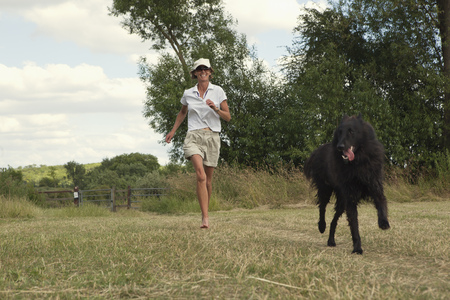 pursued: Woman running with dog