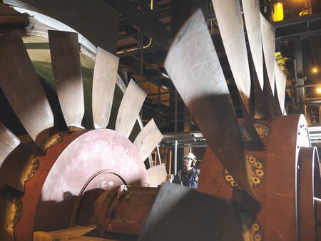 Worker inspecting cooling fan