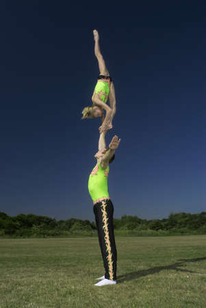 jeopardizing: Acrobatic troop performing moves LANG_EVOIMAGES