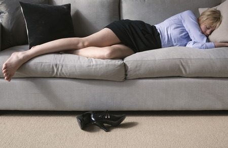 heartache: Woman sleeping on sofa