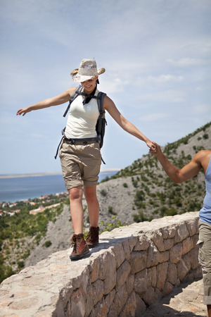 help section: Hiker balancing on wall