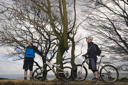 ceased: Couple mountain biking in countryside
