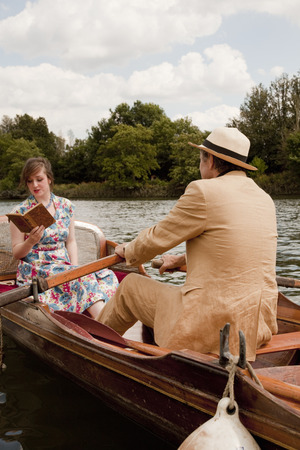 Father and daughter on a vintage boat