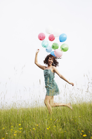 whimsy: Woman with air balloons jumping