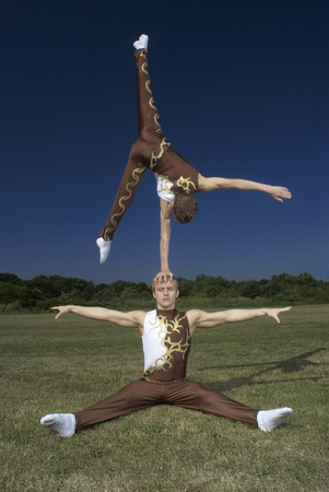 arms lifted up: Acrobatic troop performing moves LANG_EVOIMAGES