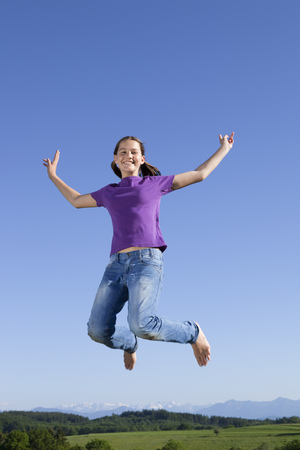 low spirited: Girl jumping in air, happy