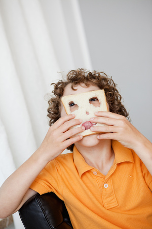 Boy making fun with a toast bread