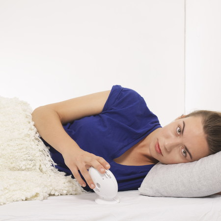 avoidance: Woman reclined with alarm clock