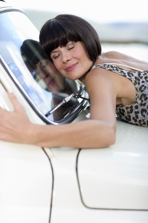 mischievious: Woman loving her car