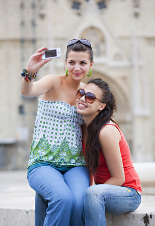 Young women taking photo of themselves