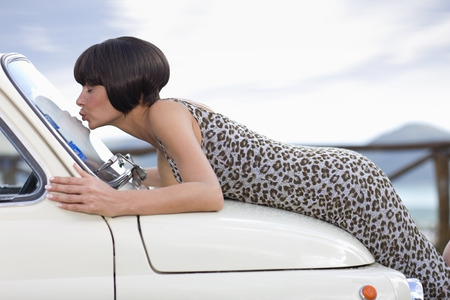 whimsy: Woman kissing a car