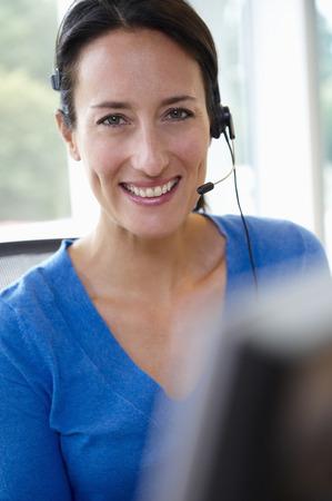 Receptionist behind her desk,smiling