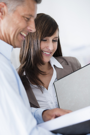 Business couple looking at file