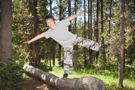 intersects: Boy balancing on log