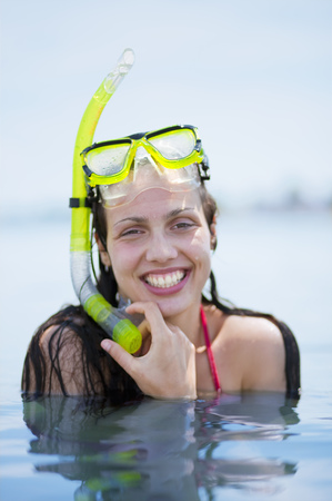 Woman snorkeling at the beach LANG_EVOIMAGES