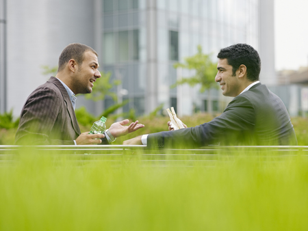 Businesspeople eating outdoors LANG_EVOIMAGES