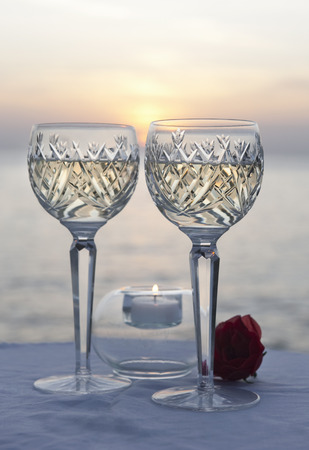 A couple of glasses of wine at sunset
