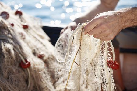 appendages: Fisherman holding nets LANG_EVOIMAGES