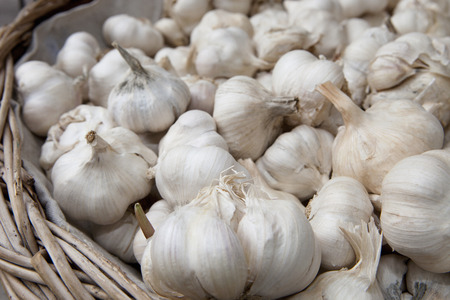 retailer: Garlic cloves in a basket