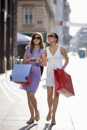 path to wealth: Young women shopping