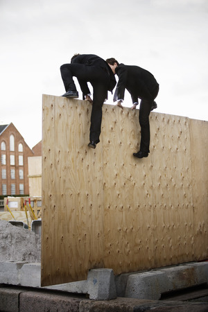 welldressed: To men climbing wall