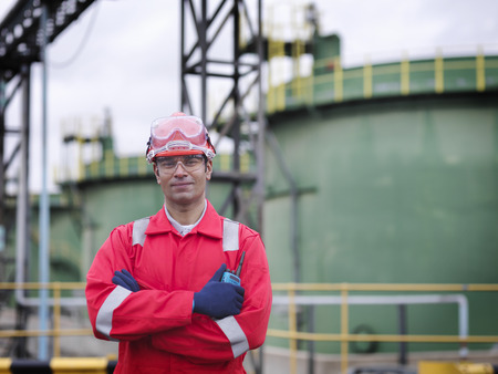 Worker in front of oil tank
