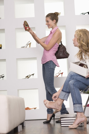 Women in shoe shop