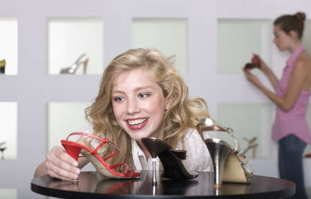 browses: Young woman in shoe shop