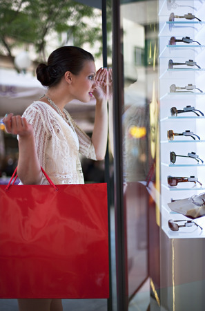 selections: Young woman window shopping