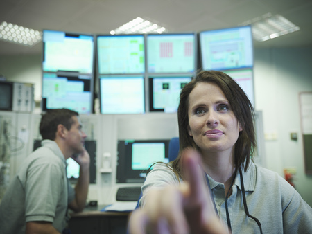 review: Scientists in accelerator control room