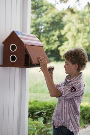 Boy in front of mail box