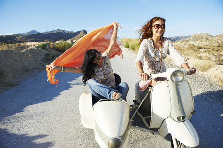 remoteness: Women driving with motorbike and sidecar