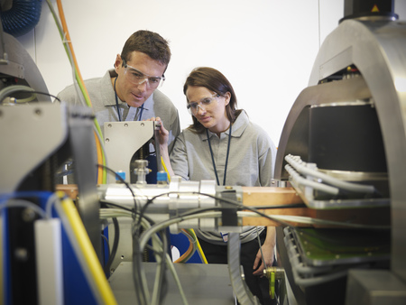 accurately: Scientists with particle accelerator