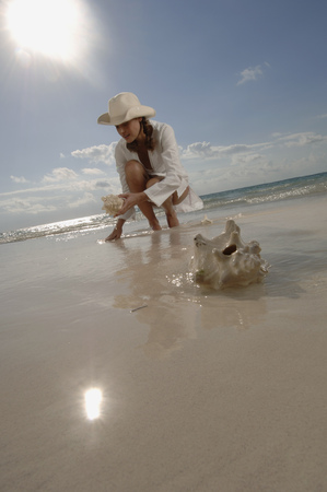 barefoot cowboy: Woman collecting clams