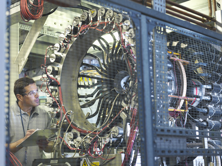 rd: Scientist inspects particle accelerator