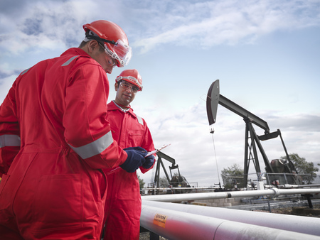 Workers with oil wells