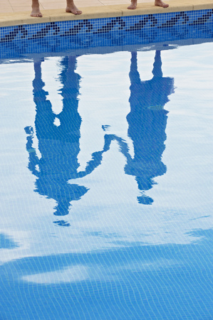 Reflection of couple holding hands