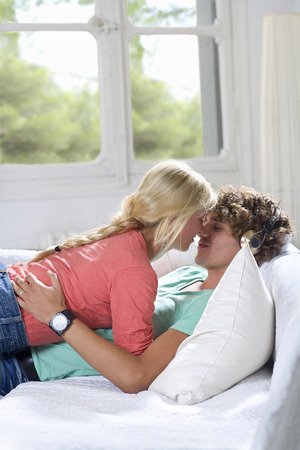 Young loving couple on couch at home